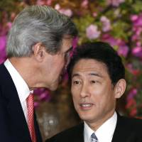 U.S. Secretary of State John Kerry has a private word with Foreign Minister Fumio Kishida as they shake hands after their joint press conference at the ministry's Iikura Guesthouse in Tokyo. | AP