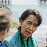 Myanmar opposition leader Aung San Suu Kyi speaks to the media during her visit to Kyoto on Sunday. | KYODO