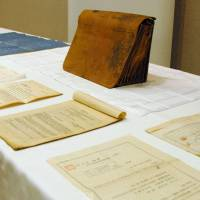 Time capsule: Draft plans and other documents from the 1920s linked to U.S. architect Jay Hill Morgan are displayed in Yokohama on Thursday, alongside the briefcase they were found in. | KYODO