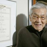 In recognition: Actor Rentaro Mikuni stands next to his 1987 Cannes International Film Festival award in this file photo taken in 2010 in Tokyo. | KYODO