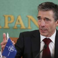 Extended reach: NATO Secretary General Anders Rasmussen holds a news conference Monday at the Japan National Press Club in Tokyo ahead of talks with top Japanese officials. | AP