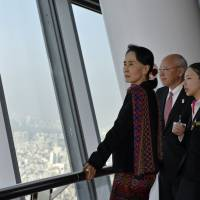 Expanded horizons: Aung San Suu Kyi enjoys the view from the 350-meter observation deck in Tokyo Skytree on Thursday. | AP