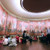 Soaking it in: Visitors view the famous tapestries of 'The Lady and the Unicorn' ('La Dame a la Licorne') in Paris. | AFP-JIJI