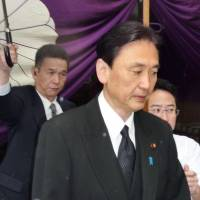 Double talker: Keiji Furuya, state minister in charge of addressing North Korea's abductions of Japanese, visits war-related Yasukuni Shrine in Tokyo on Sunday. | KYODO