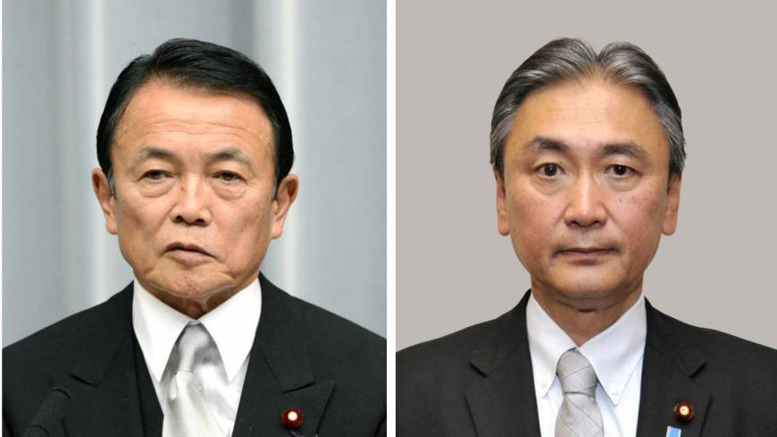 No fear: Deputy Prime Minister Taro Aso (left) and Keiji Furuya, state minister in charge of the abduction issue, visited controversial Yasukuni Shrine in Tokyo on Sunday.