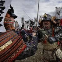 Cut and thrust: Men dressed as samurai fight in a re-enactment of the 16th-century Battle of Kawanakajima, on Sunday in Fuefuki, Yamanashi Prefecture. | AP