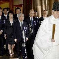 Contentious visit: A group of Diet members visit Yasukuni Shrine in Tokyo on Tuesday morning. | KYODO