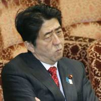 Splitting hairs: Prime Minister Shinzo Abe attends an Upper House budget committee meeting Thursday. | KYODO