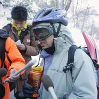 Narrow miss: A climber who was part of a group that was struck by an avalanche Saturday on Mount Shirouma in Nagano Prefecture recounts the experience after reaching the nearby village of Hakuba. | KYODO