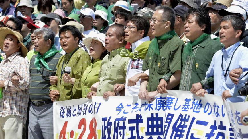 No to Tokyo: People protest the first state ceremony commemorating the return of Japanese sovereignty in Ginowan, Okinawa Prefecture, on Sunday. For Okinawans, the 'day of shame' when the San Francisco Peace Treaty took effect was the day it was abandoned and left under U.S. control until 1972