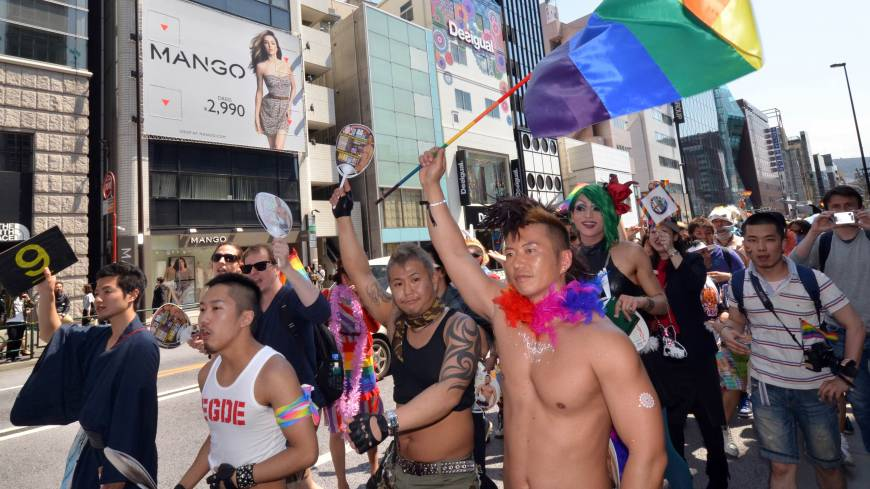 Out and about: Lesbian, gay, bisexual and transgender people and their supporters take part in the 'Tokyo Rainbow Pride' parade in Shibuya Ward's posh Harajuku shopping district on Sunday.