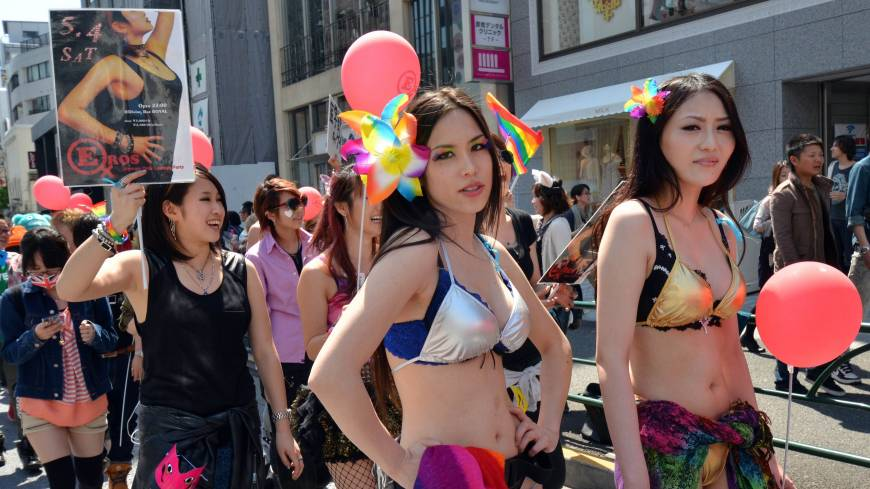 Drawing attention: Bikini-clad women march in the 'Tokyo Rainbow Pride' parade Sunday in the Harajuku district to support lesbian, gay, bisexual and transgender people.