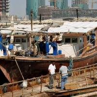 Clutching at pearls: A traditional wooden boat once used to harvest pearls is moored in the port of Manama, capital of Bahrain, in October 2010. Japan and Bahrain will jointly study pearl oysters in the Persian Gulf in a bid to revive the region's pearl tradition, which has not thrived since the early 20th century. | KYODO