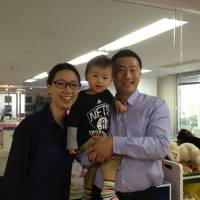 Room to work: Yushi and Minhee Katayama pose with their son, Shota, at their coworking space Hatch in the Akasaka area of Tokyo on April 16. | AYAKO MIE