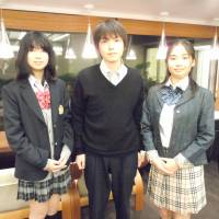 Change of dress: Three high school students wear their fake school uniforms in Minato Ward, Tokyo, on April 20. | TOMOHIRO OSAKI