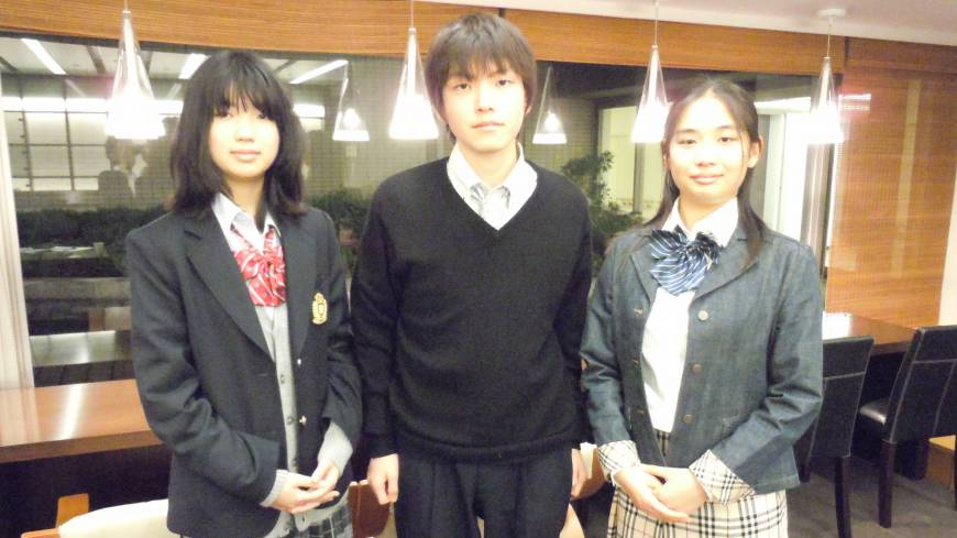 Change of dress: Three high school students wear their fake school uniforms in Minato Ward, Tokyo, on April 20.