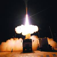 On guard: The land-based missile defense system heading for the Pacific island of Guam includes a truck-mounted launcher, tracking radar and interceptor missiles.   | LOCKHEAD MARTIN/KYODO