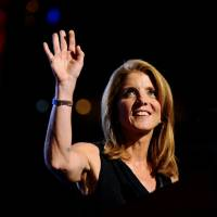 Setting the stage: Caroline Kennedy Schlossberg waves before introducing her uncle, the late Sen. Edward 'Ted' Kennedy of Massachusetts, on the opening day of the 2008 Democratic National Convention in Denver on Aug. 25, 2008. | BLOOMBERG