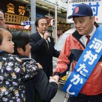 Pressing the flesh: Nagoya Mayor Takashi Kawamura shakes hands with supporters in Naka Ward on Sunday as three candidates kicked off their campaigns for mayor.  | KYODO