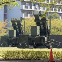 Vigilant: PAC-3 batteries remain on alert Friday outside the Defense Ministry in Shinjuku Ward, Tokyo. | KYODO