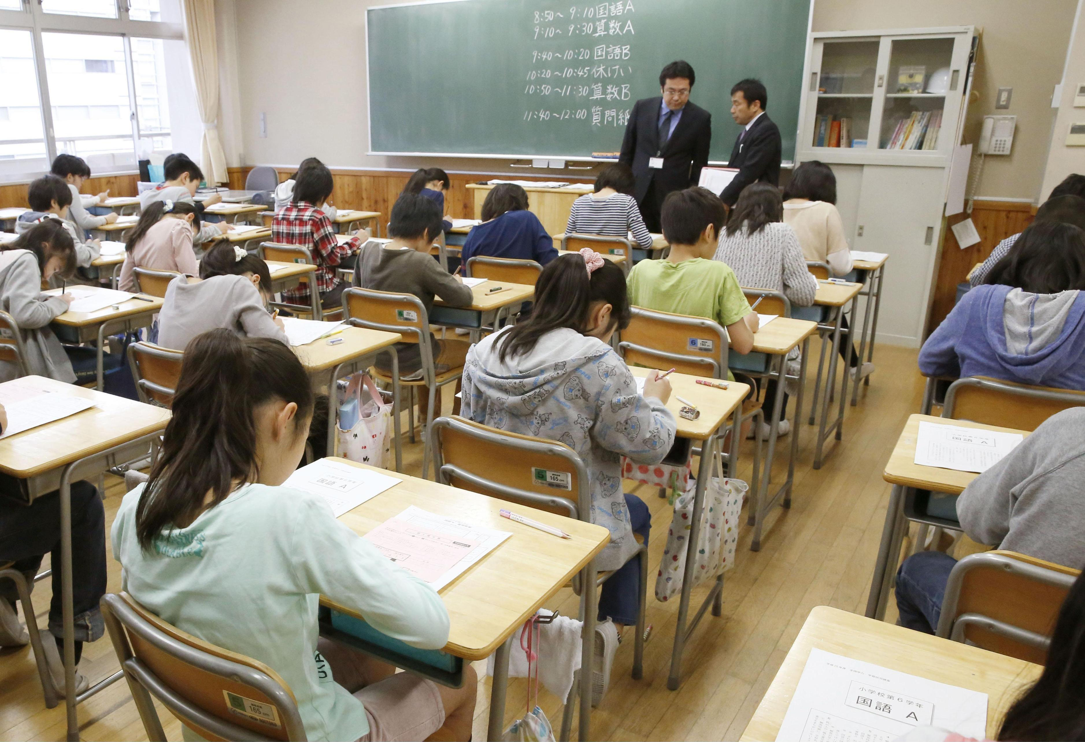 ... examination at an elementary school in Tokyo on Wednesday. | KYODO