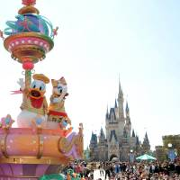 Webfoot sites: Donald Duck and Daisy wave to visitors during a press preview of a parade Thursday at Tokyo Disneyland in Urayasu, Chiba Prefecture. | YOSHIAKI MIURA