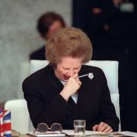Prime Minister Margaret  Thatcher yawns while attending the Conference on Security and Cooperation in Europe in Paris in November 1990.  | AFP-JIJI