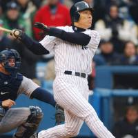 Smashing start: Hideki Matsui watches his grand slam leave the yard in the fifth inning against the Minnesota Twins in his first game at Yankee Stadium on April 8, 2003. | KYODO