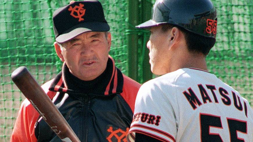 Lesson from the legend: Yomiuri Giants manager Shigeo Nagashima, who hit 444 home runs during his career, speaks to rookie slugger Hideki Matsui during the 1993 season.