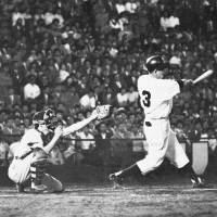 Mythical moment: Yomiuri Giants third baseman Shigeo Nagashima hits a game-winning home run against the Hanshin Tigers on June 25, 1959, at Korakuen Stadium as Emperor Hirohito looked on. | KYODO
