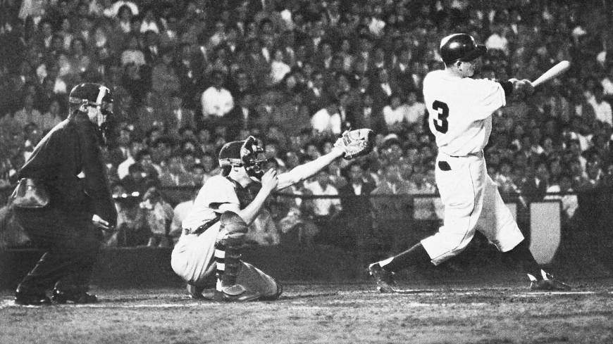 Mythical moment: Yomiuri Giants third baseman Shigeo Nagashima hits a game-winning home run against the Hanshin Tigers on June 25, 1959, at Korakuen Stadium as Emperor Hirohito looked on.