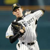 Streak stopper: The Tigers' Atsushi Nomi tosses a five-hit shutout on Tuesday as Hanshin defeated the Yomiuri Giants 2-0 at Koshien Stadium. | KYODO