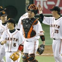 That's more like it: The Giants congratulate each other after a win over the Tigers on Tuesday. | KYODO