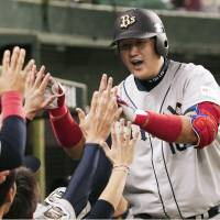 Sharing the joy: The Buffaloes' Lee Dae Ho is congratulated by teammates after belting a solo home run in the seventh inning against the Lions on Wednesday at Seibu Dome. Orix defeated Seibu 2-1. | KYODO