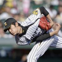 Happy hunting: Hanshin starter Shintaro Fujinami delivers a pitch during the Tigers' 5-0 win over the Tokyo Yakult Swallows on Sunday. | KYODO