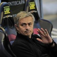 Agitator: Real Madrid manager Jose Mourinho has stirred up controversy again with his recent comments about leaving the Spanish League club. | AFP-JIJI