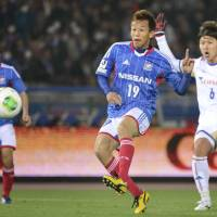 Capital punishment: Toshihito Fujita scores in the 90th minute to give Yokohama F. Marinos a 3-2 win over FC Tokyo on Saturday. | KYODO