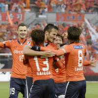 Amazing run: Omiya Ardija, celebrating Zlatan Ljubijankic's goal in the 47th minute, extends its unbeaten streak to 18 games by beating Urawa Reds 1-0 on Saturday. | KYODO