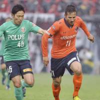 Hot streak: Omiya Ardija striker Zlatan Ljubijankic (right) has scored in each of his team's last three J. League games. | KYODO