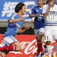 Another one for the record books: Shunsuke Nakamura of Yokohama F. Marines celebrates after scoring on a free kick in the fourth minute against Ventforet Kofu on Saturday in Yokohama. The match ended in a 1-1 draw. | KYODO