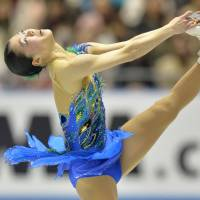 Elegance on ice: Akiko Suzuki performs her free skate on Saturday at the World Team Trophy at Yoyogi National Gymnasium. Suzuki won the event with 199.58 points. | AFP-JIJI