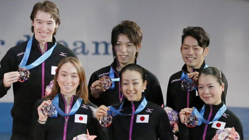 Team effort: Japanese figure skaters stand together during the awards ceremony after receiving their third-place medals at the World Team Trophy on Saturday.