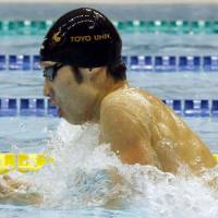 Making history: Kosuke Hagino swims to victory in the men's 200 individual medley on Saturday at national championships in Nagaoka, Niigata Prefecture. Hagino became the first Japanese to win five events at the national championships. | KYODO