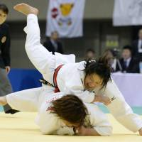 Over and out: Akari Ogata (top) beats Megumi Tachimoto to win the final of the All Japan Women's National Championship on Sunday. | KYODO