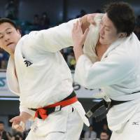 Happy ending: Takamasa Anai (left) competes against Hisayoshi Harasawa on his way to victory in the All Japan Judo Championship in Tokyo on Monday. | KYODO