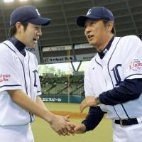 Follow my lead: Lions manager Hisanobu Watanabe (right) helped the Lions win a Japan Series title as a pitcher and is hoping Yusei Kikuchi (left) can one day do the same. | KYODO