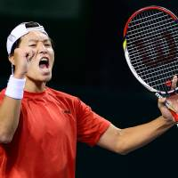 The world is waiting: Japan's Tatsuma Ito celebrates after beating South Korea's Cho Min Hyeok in their Davis Cup Asia/Oceania Group I singles match on Sunday. | AFP-JIJI