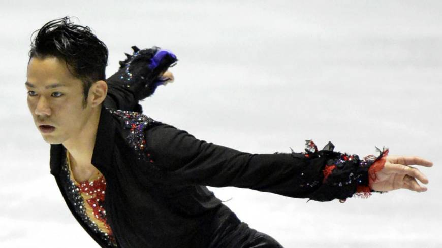 Grabbing the spotlight: Daisuke Takahashi performs in the men's free skate on Friday at the World Team Trophy at Yoyogi National Gymnasium. Takahashi finished first with 249.52 points.