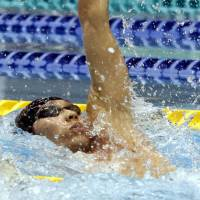 Making a splash: Kosuke Hagino wins the men's 100-backstroke title at the national championships on Friday in Nagaoka, Niigata Prefecture, completing the race in 53.10 seconds. | KYODO