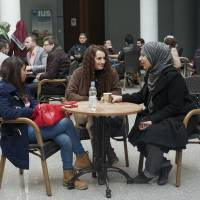 Talking shop: Students converse in a cafe at the Turkish-backed International University of Sarajevo. Turkey conquered the Balkans five centuries ago, and now Turkish power is making inroads through friendlier means. | THE WASHINGTON POST